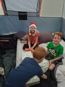 Kids on airbeds while camping in tent